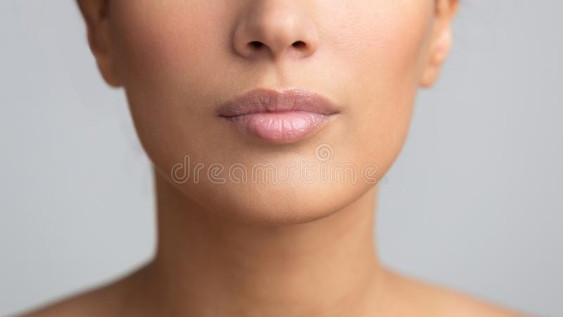 Beauty plastic. Perfect lips after filler injections stock image