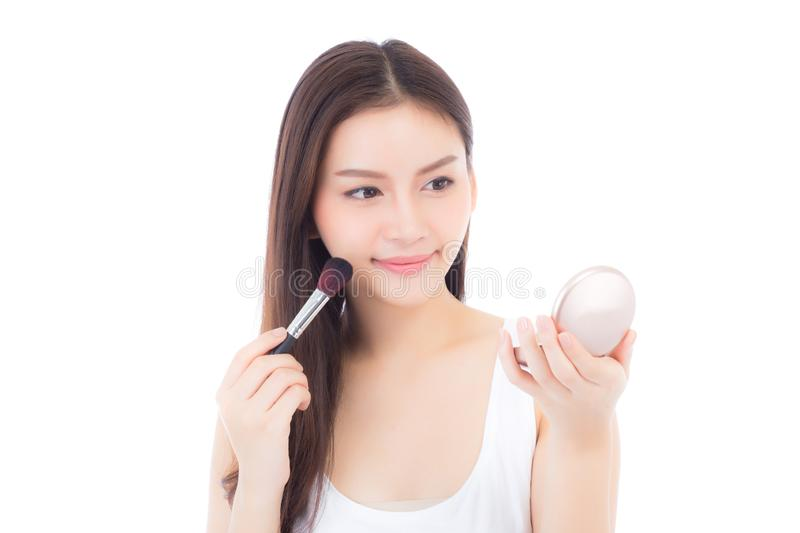 Beauty of portrait asian woman applying make up with brush of cheek isolated on white background. Beautiful of girl holding blusher, skincare and cosmetioncept stock image
