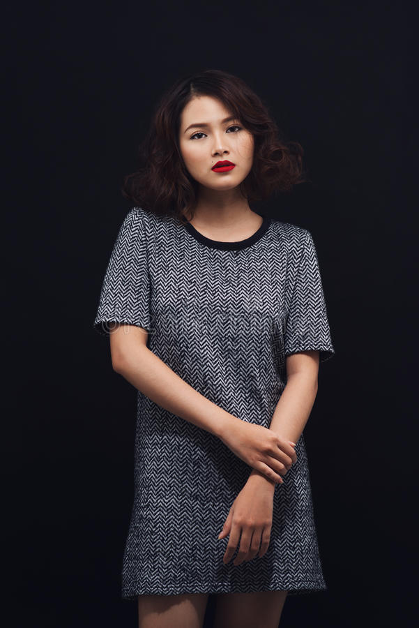 Beauty portrait of asian woman. Magnificent model posing on black background. stock photos