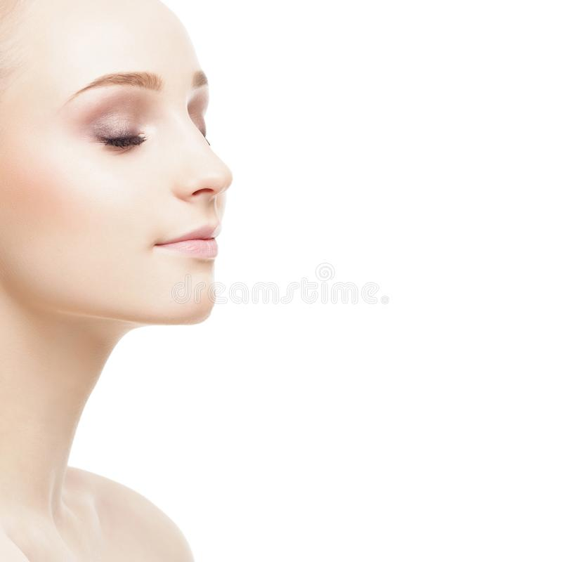 Beauty portrait of attractive blond girl. Makeup and cosmetics concept. Portrait of young and beautiful blond woman. Makeup and cosmetics, face lifting and stock photo