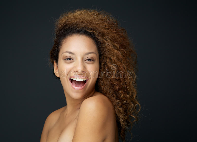 Beauty portrait of an attractive woman laughing with curly hair royalty free stock photo