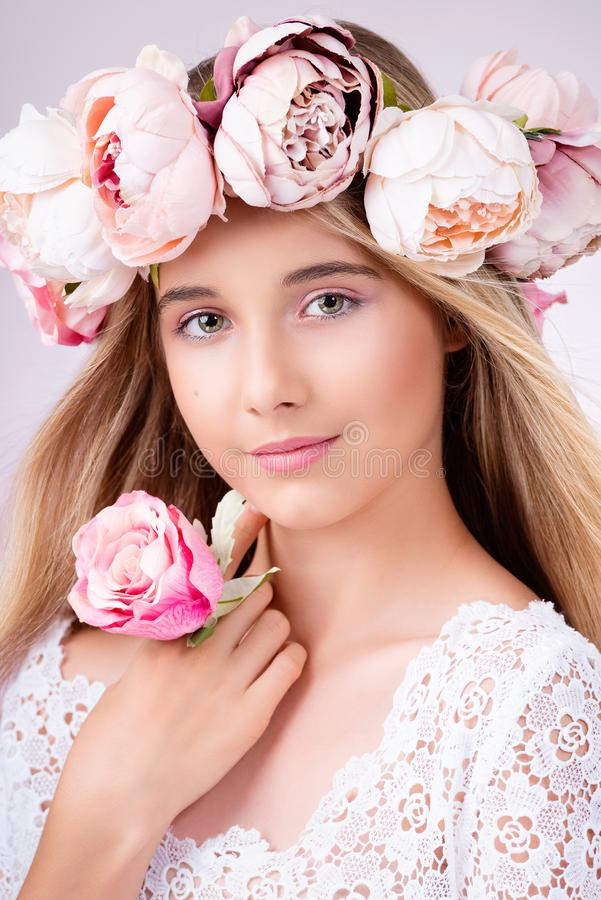 Beauty portrait. Beautiful blonde girl with wreath of flowers. royalty free stock images