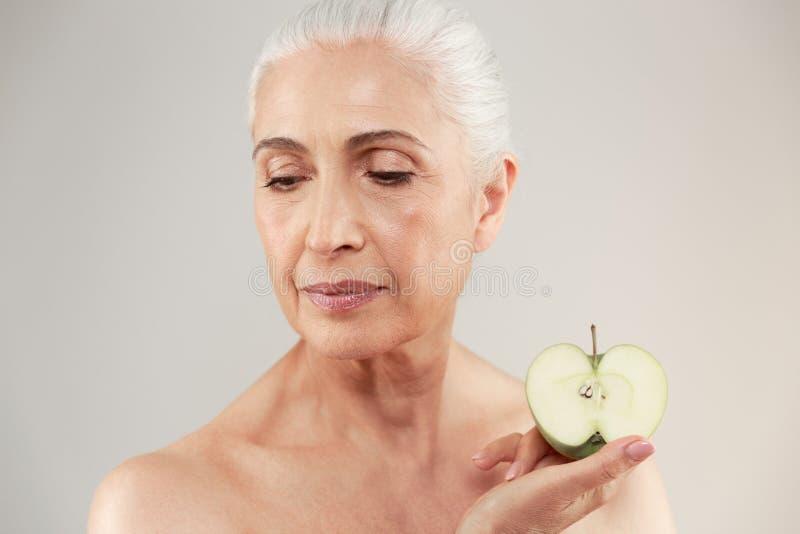 Beauty portrait of a beautiful half naked elderly woman stock photo