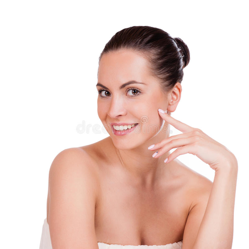 Beauty Portrait. Beautiful Spa Woman Touching her Face. Isolated stock photos