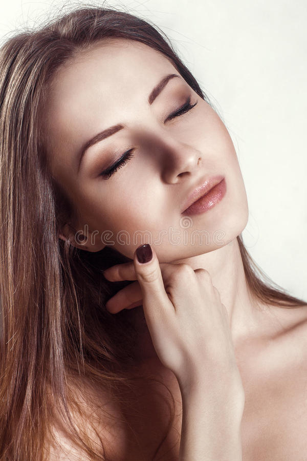 Beauty Portrait. Beautiful Spa Woman Touching her Face. Perfect Fresh Skin royalty free stock photo