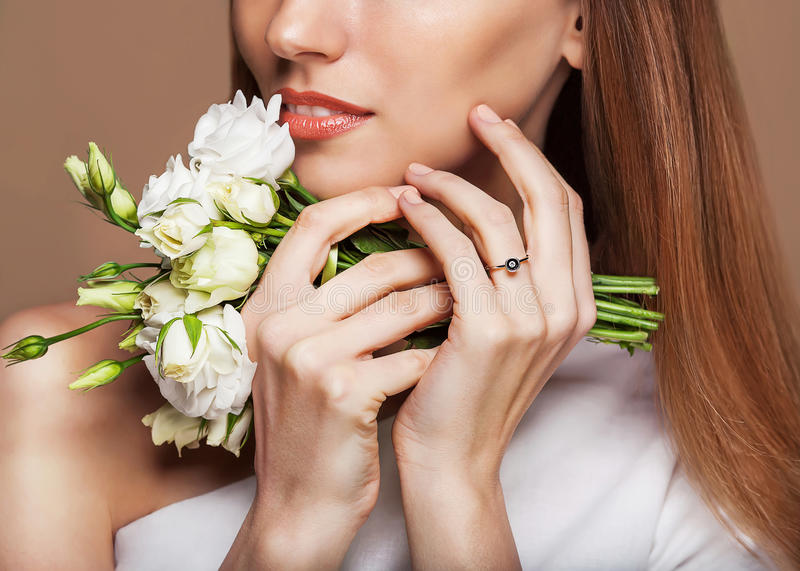 Beauty Portrait. Beautiful Spa Woman Touching her Face. royalty free stock images