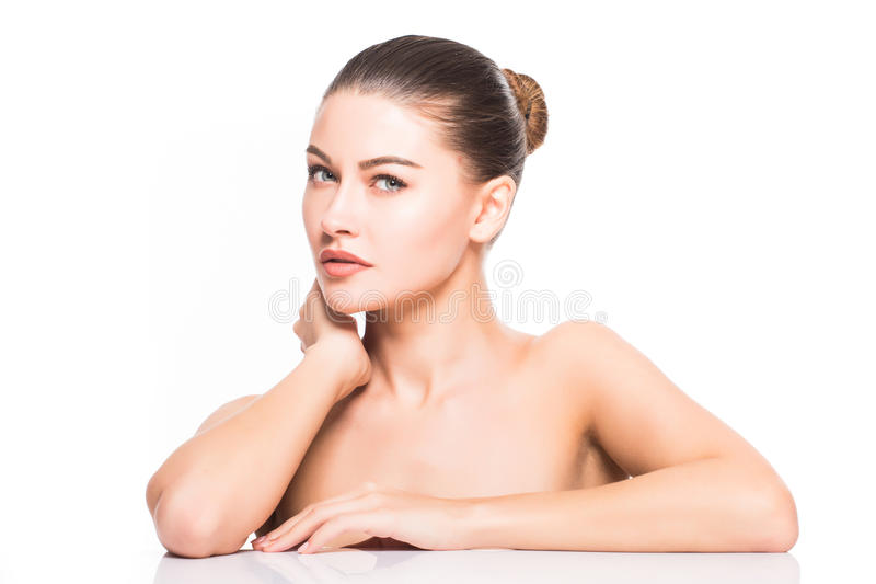 Beauty Portrait. Beautiful Spa Woman Touching her Face. Perfect Fresh Skin. Isolated on White Background. Pure Beauty. Model. Youth and Skin Care Concept stock images