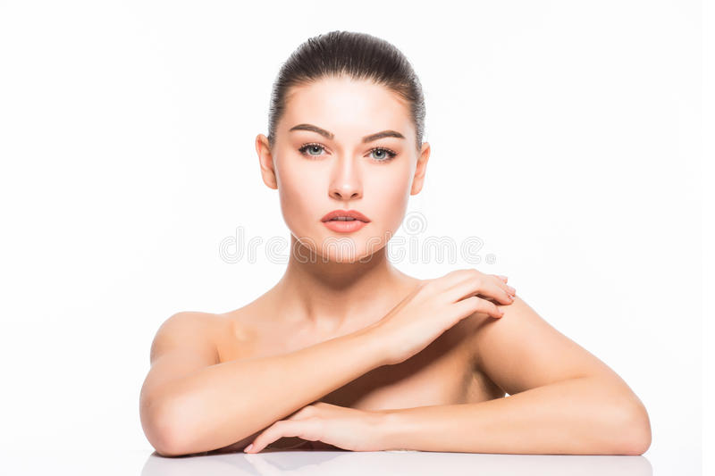 Beauty Portrait. Beautiful Spa Woman Touching her Face. Perfect Fresh Skin. Isolated on White Background. Pure Beauty. Model. Youth and Skin Care Concept royalty free stock photo