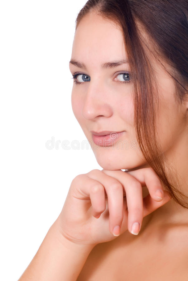 Beauty Portrait. Beautiful Spa Woman Touching her Face royalty free stock image