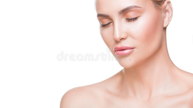 Beauty portrait of beautiful young woman with closed eyes. Pure, natural skin. Isolated on white stock photo