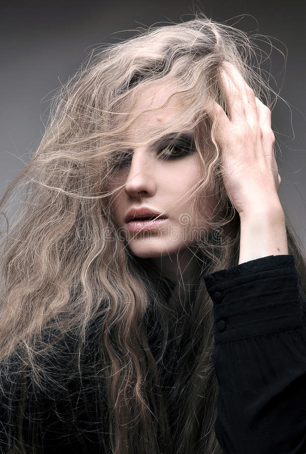 Beauty portrait of blond woman with curly hair, and evening make up stock photo