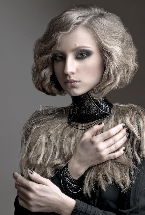 Beauty portrait of blond woman with curly hair, and evening make up stock images