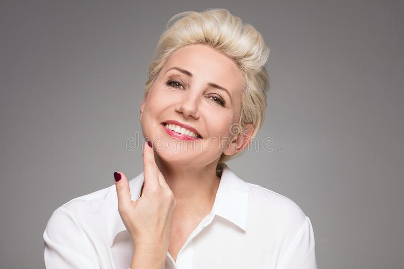 Portrait of elegant blonde middle aged woman. royalty free stock photos