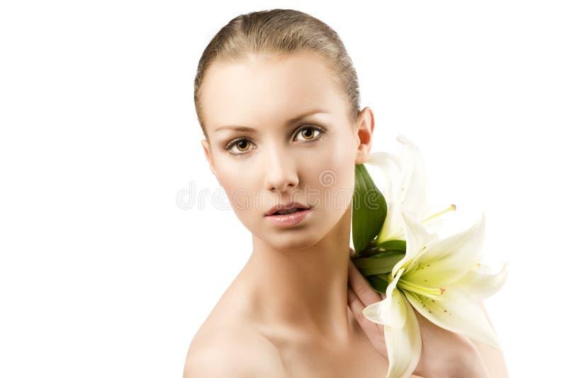 Beauty portrait with flowers on shloulder