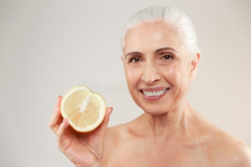 Beauty portrait of a happy half naked elderly woman stock image