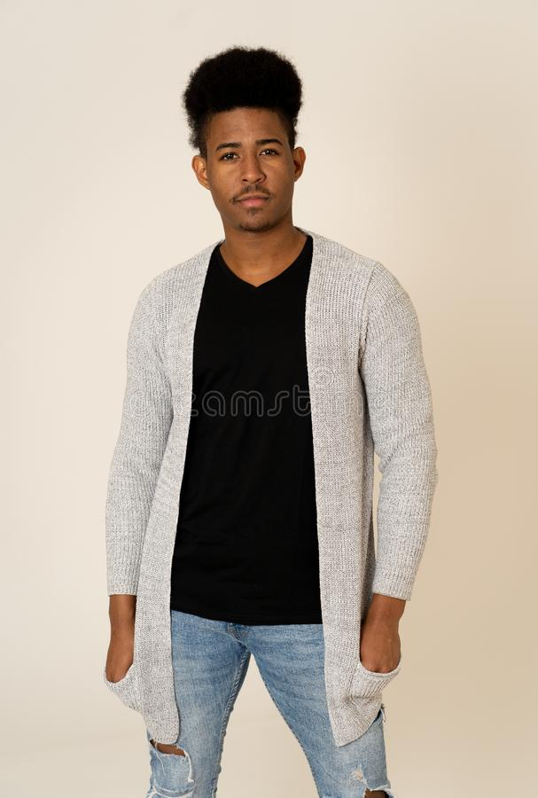Beauty portrait of happy young attractive african american man having fun modeling stock image
