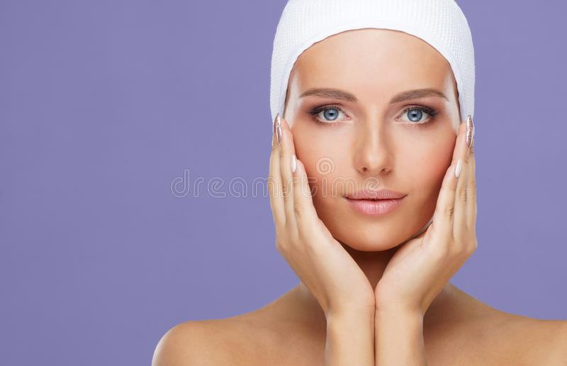 Beauty portrait of healthy and attractive woman. Human face in a concept of spa, skin care, cosmetics, make-up royalty free stock photos