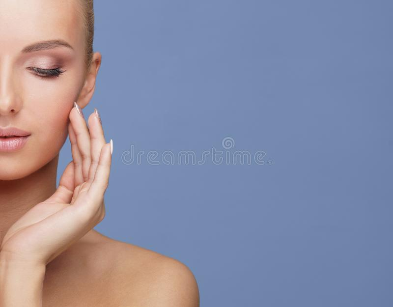 Beauty portrait of healthy and attractive woman. Human face in a concept of spa, skin care, cosmetics, make-up stock images