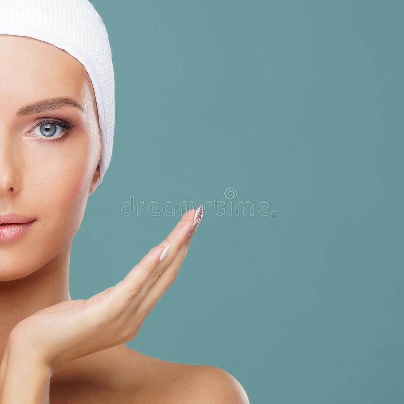 Beauty portrait of healthy and attractive woman. Human face in a concept of spa, skin care, cosmetics, make-up. Beauty portrait of healthy and attractive woman stock photo