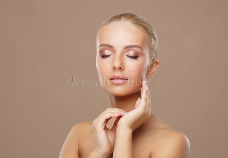 Beauty portrait of healthy and attractive woman. Human face in a concept of spa, skin care, cosmetics, make-up stock photography