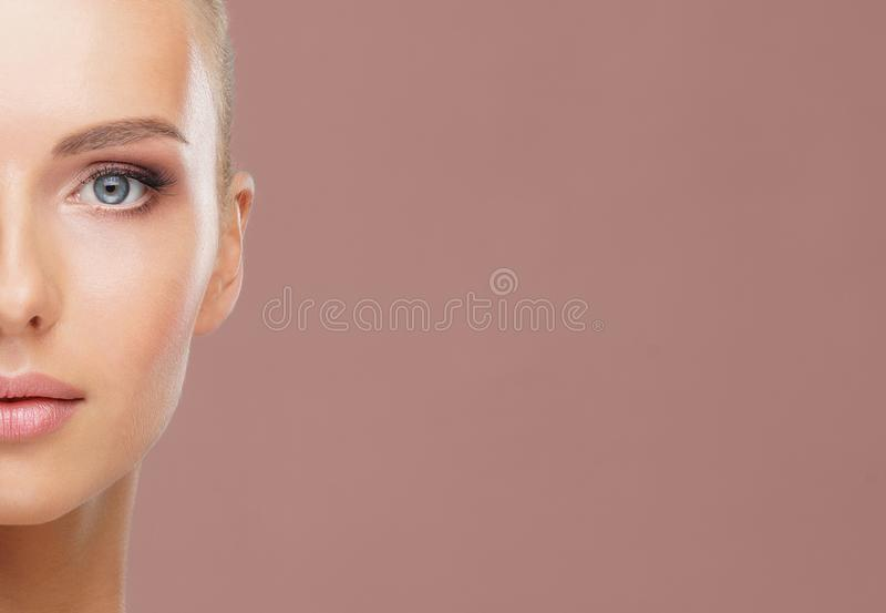 Beauty portrait of healthy and attractive woman. Human face in a concept of spa, skin care, cosmetics, make-up royalty free stock photography