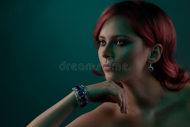 Beauty portrait with jewelry bracelet. Beauty portrait of woman with beautiful jewelry bracelet with blue stones royalty free stock photography