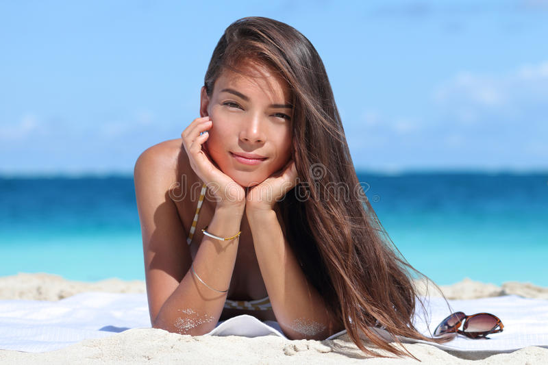 Beauty portrait of mixed race woman on beach. Beauty portrait of mixed race Asian Caucasian woman on beach. Young lady with perfect skin wearing bikini and royalty free stock image