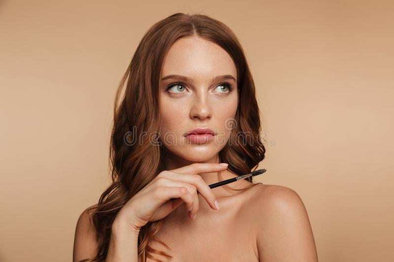 Beauty portrait of mystery ginger woman with long hair royalty free stock photo