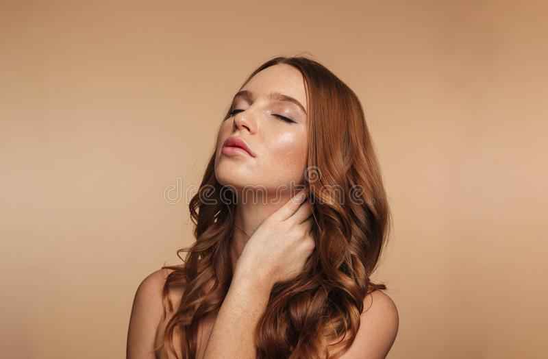 Beauty portrait of mystery ginger woman with long hair posing stock photo