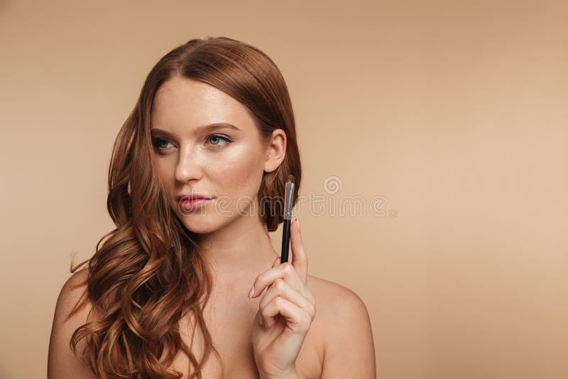 Beauty portrait of mystery smiling ginger woman with long hair stock images