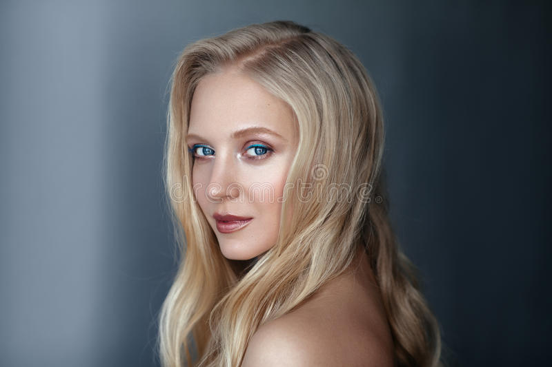 Beauty portrait of nordic natural blonde woman on dark background royalty free stock images