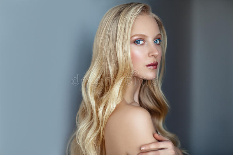 Beauty portrait of nordic natural blonde woman on dark background. With copy space stock images