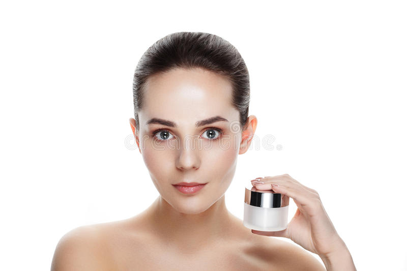 Beauty portrait of pretty girl with natural makeup hold face cream. Commercial photo for promotion cosmetic. Youth and skin care stock photo