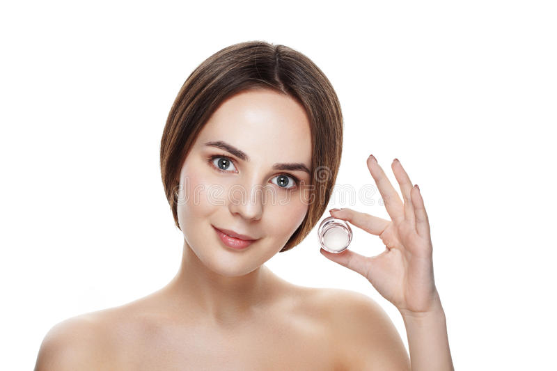 Beauty portrait of pretty girl with natural makeup hold face cream. Commercial photo for promotion cosmetic. Youth and skin care stock image
