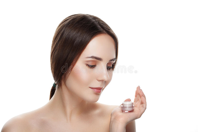 Beauty portrait of pretty girl with natural makeup hold face cream. Commercial photo for promotion cosmetic. Youth and skin care royalty free stock photos