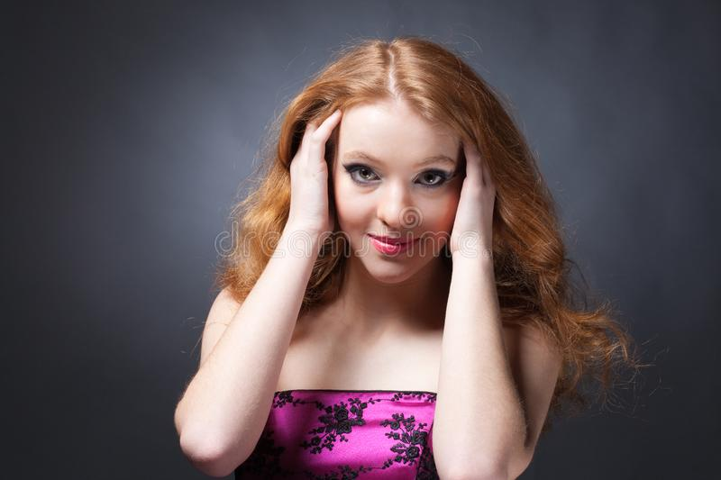 Beauty portrait of a sensitive red-haired woman stock photo
