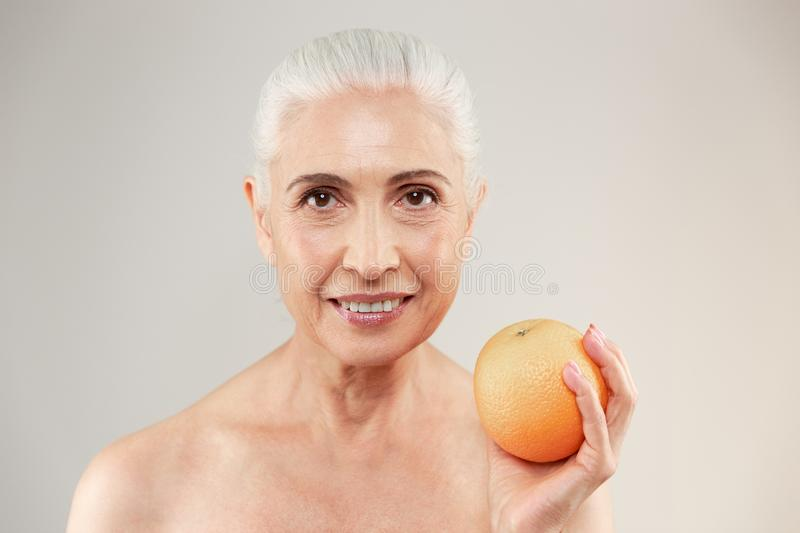 Beauty portrait of a smiling half naked elderly woman stock image