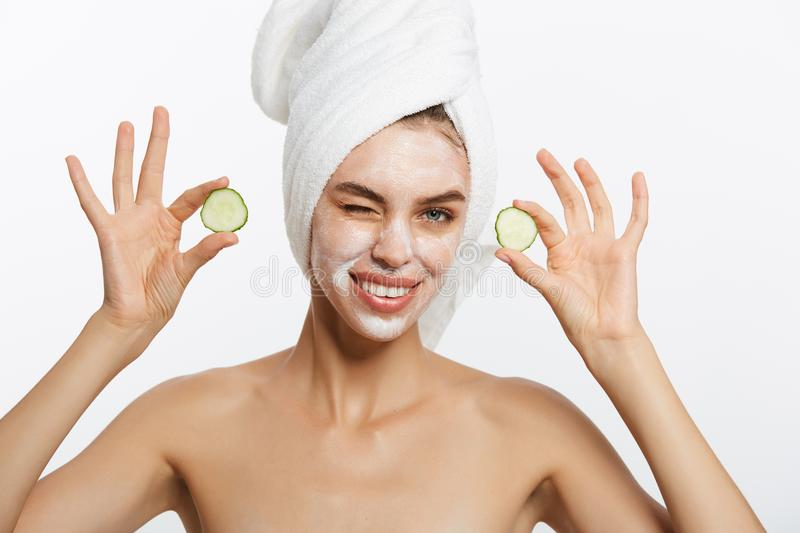 Beauty Portrait Of Smiling Woman With Towel On Head And Slice Of Cucumber In Hand Isolated On White Background. Beauty Portrait Of Smiling Woman With Towel On stock images