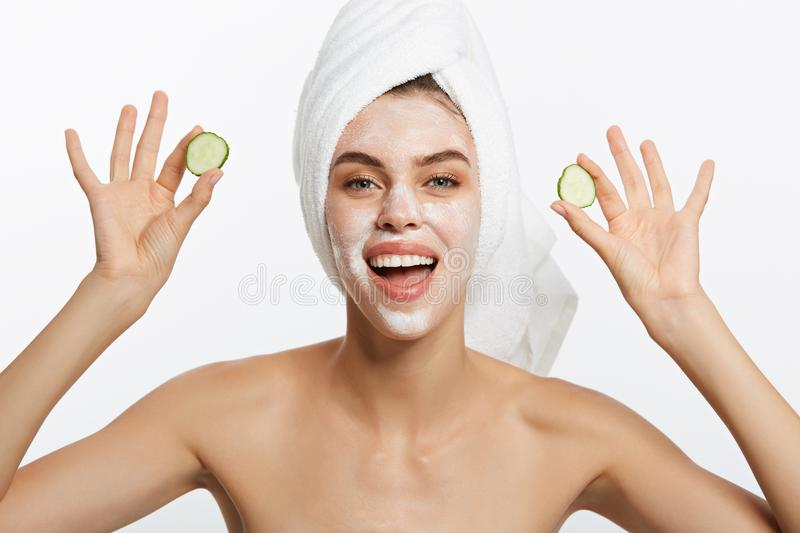 Beauty Portrait Of Smiling Woman With Towel On Head And Slice Of Cucumber In Hand Isolated On White Background. Beauty Portrait Of Smiling Woman With Towel On royalty free stock photos