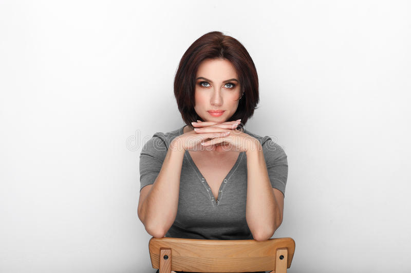 Beauty portrait sporty adult adorable fresh looking brunette woman gorgeous makeup bob hairdo posing white background showing emot. Ion and facial expression stock images