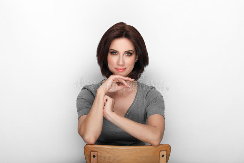 Beauty portrait sporty adult adorable fresh looking brunette woman gorgeous makeup bob hairdo posing white background showing emot. Ion and facial expression royalty free stock photography