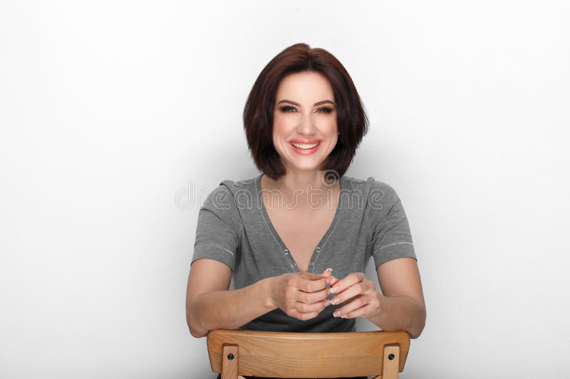 Beauty portrait sporty adult adorable fresh looking brunette woman gorgeous makeup bob hairdo posing white background showing emot. Ion and facial expression royalty free stock image