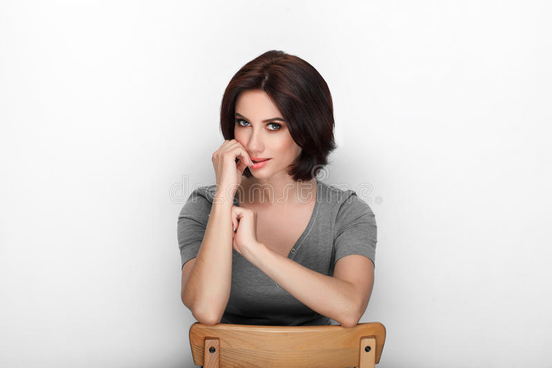 Beauty portrait sporty adult adorable fresh looking brunette woman gorgeous makeup bob hairdo posing white background showing emot. Ion and facial expression royalty free stock photos