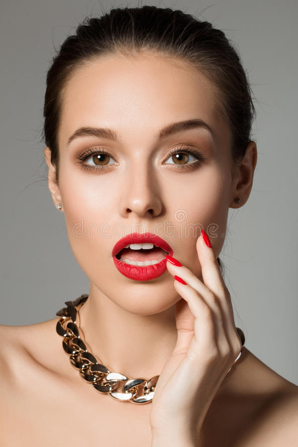 Beauty portrait of surprised young brunette woman stock photos