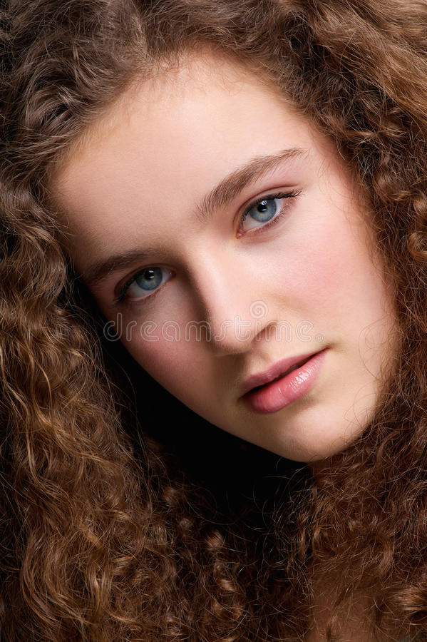 Beauty portrait teenage female fashion model with curly hair royalty free stock photos