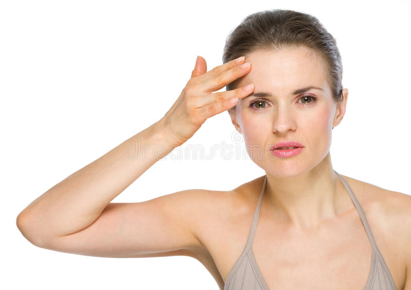 Beauty portrait of woman checking facial skin stock images