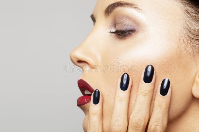 Beauty Portrait Woman close-up perfect makeup. Beautiful Spa model Girl Fresh Clean Skin and black nail polish Skin Care Concept royalty free stock photos