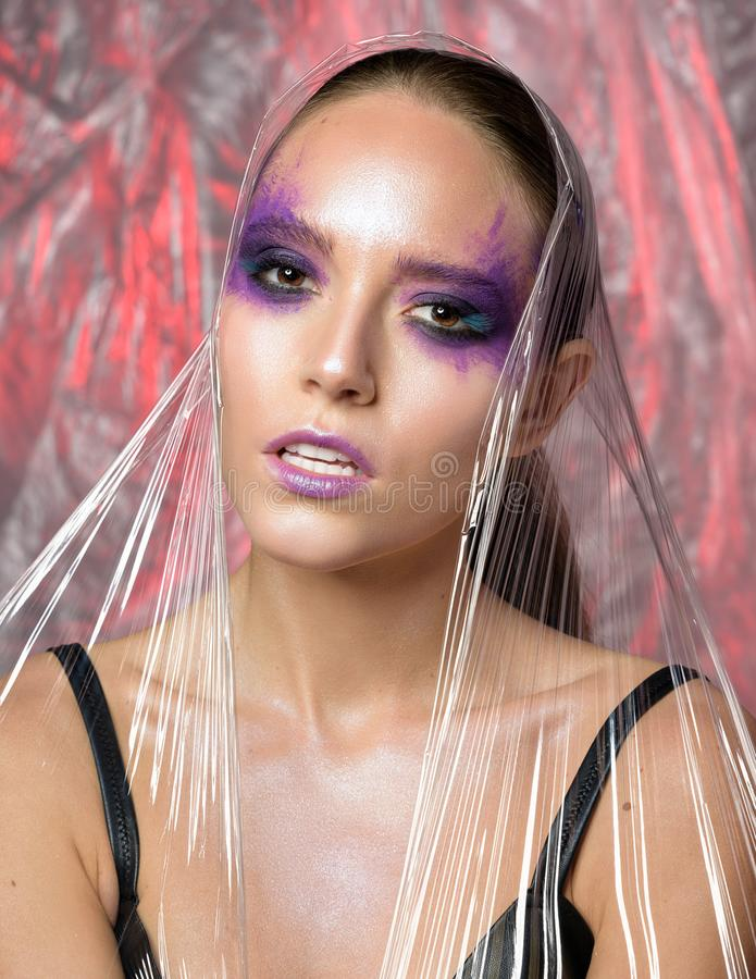 Beauty portrait of woman with creative violet makeup. royalty free stock photos