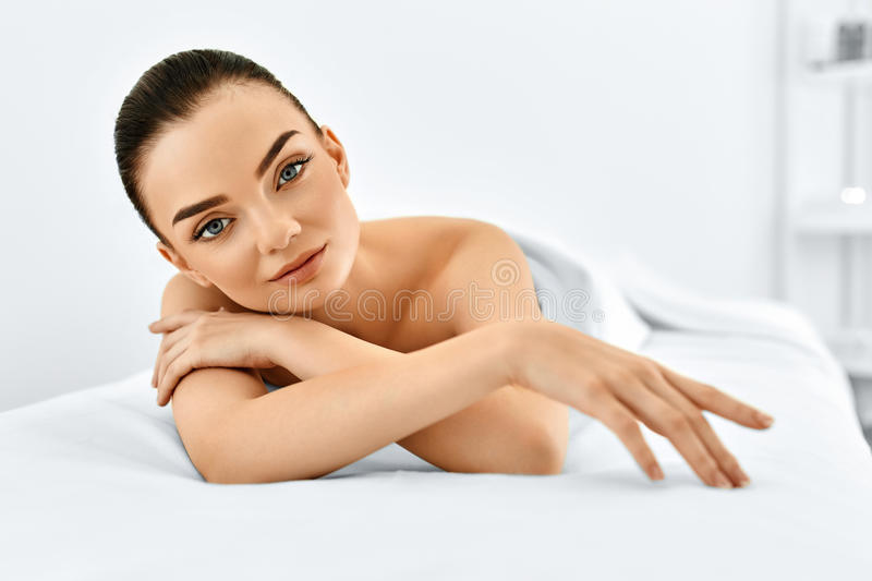 Beauty Portrait. Woman Face. Spa Body, Skin Care Concept. Beauty Portrait. Beautiful Young Model Woman's Touching Her Face. Perfect Fresh Pure Skin. Spa Body royalty free stock images