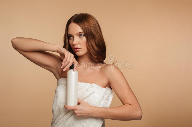 Beauty portrait of woman with long hair wrapped in towel royalty free stock photography